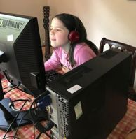 Farnborough school pupil enjoying home larning through a donated computer