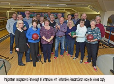 Bowling Teams from Farnborough & Farnham Lions pose for a picture at the end of the annual bowling challenge.