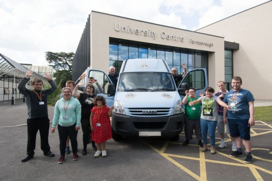 Foundation Studies students at Farnborough College of Technology celebrate the arrival of the minibus