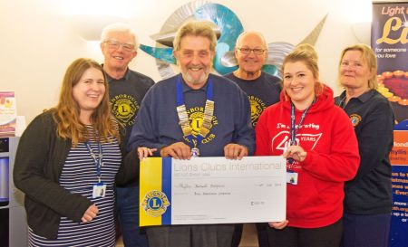 The cheque presentation to Phyllis Tuckwell Hospice by Lion President Chris Seabrook and Farnborough Lions members