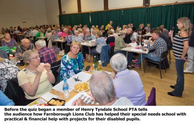 A member of Henry Tyndale Special Needs School explains to the quiz night participants how Farnborough Lions have helped with practical help and financial assistance for projects for the pupils with disablities over many years.