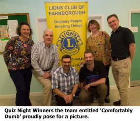 Posing proudly for a picture as winners of farnborough Lions Autumn Quiz Night the team entitled Comfortably Dumb